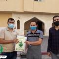 أثناء توصيل الكتب للطلاب في مدينة حمد بخان يونس