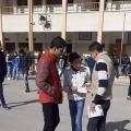 جانب من توزيع البروشورات على الطلاب