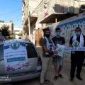 أثناء جولة توزيع الكتب على الطلاب في منازلهم