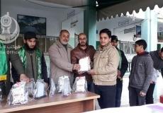 جانب من تكريم الكتلة الإسلامية في دير البلح  لدفعة جديدة من الطلبة المتفوقين في مدرسة عبدالكريم العكلوك