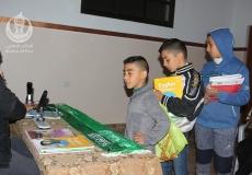 الكتلة الاسلامية في مسجد الشهيد تنفذ حملة تدبيس االكتاب المدرسي .
